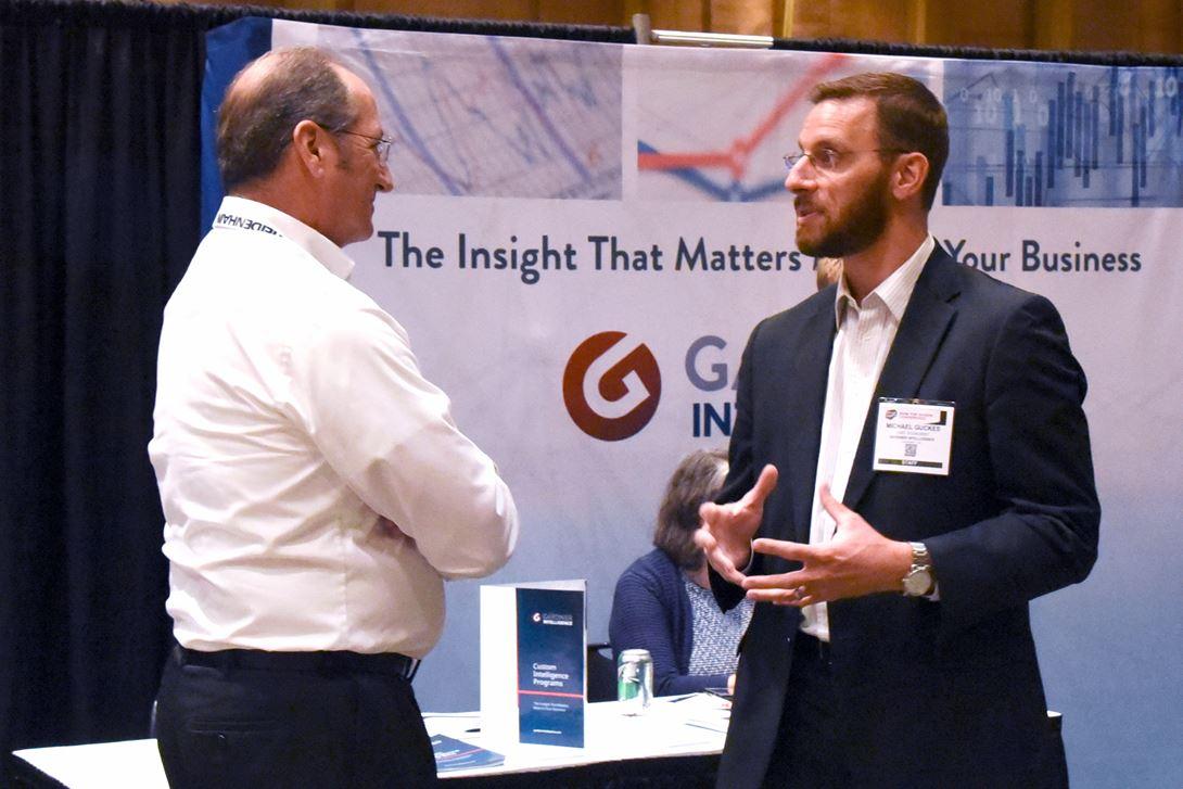 Gardner Business Media Chief Economist Michael Guckes (right)