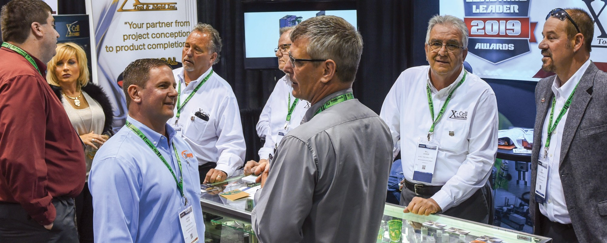 Several moldmaking professionals having a conversation on the Amerimold show floor.