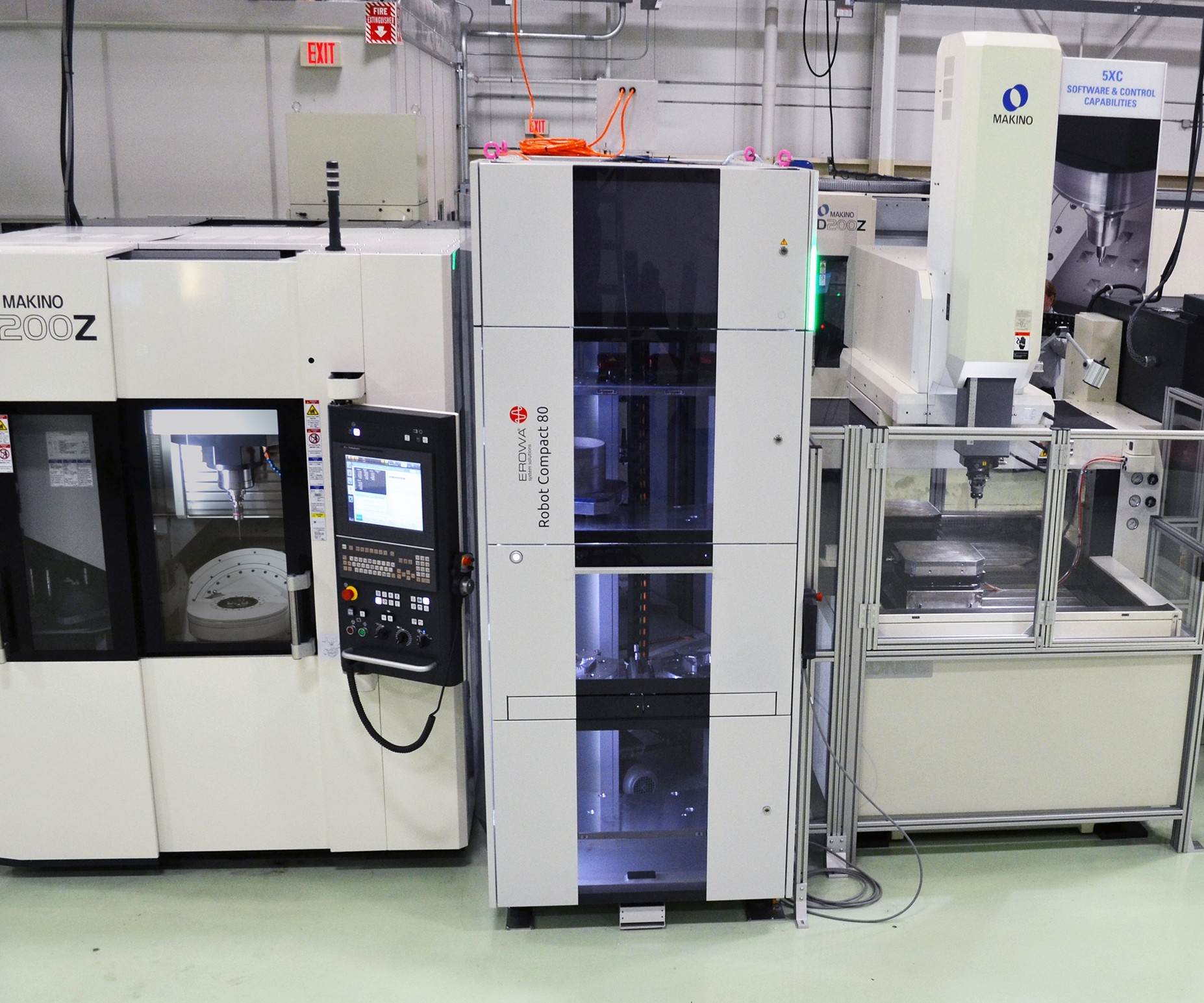 Makino's D200Z-graphite 5XC vertical machining center integrated with an automated cell that uses a Makino EDNC6 sinker EDM machine and an EROWA ERC80 robot.