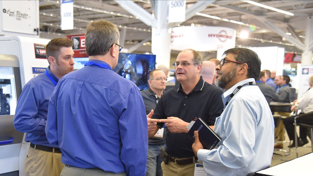 Men at an industrial trade show booth