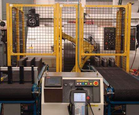 Conveyor system on robotic cell