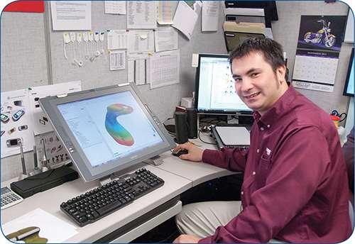 Design engineer Larry Jedik of Currier Plastics