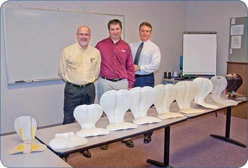 Max Leone, Larry Jedik, and Gary Kieffer of Currier Plastics with digitally printed prototypes of the PerfectSit