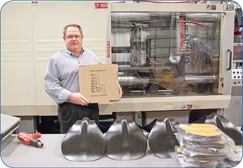 The PerfectSit is molded on a Nissei all-electric press, shown behind Currier Plastics CFO Mike Cartner