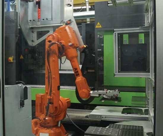 ABB 5-axis robot and an Engel molding machine