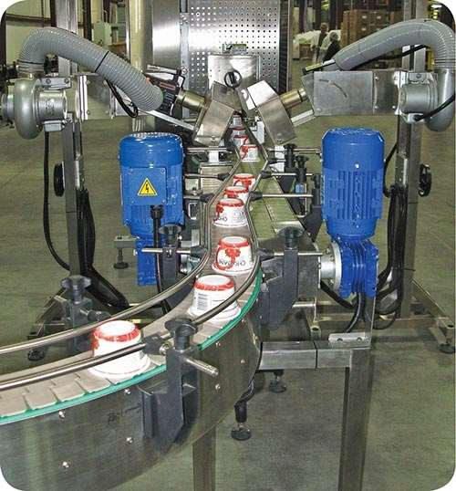 Sleeve labeling thermoformed polypropylene yogurt cups at Phoenix Packaging Group