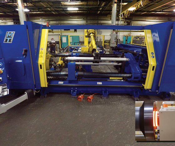 A friction welding machine. Inset  (right) shows the intersection of two workpieces that are being rotated under pressure that will result in a weld.