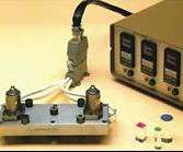 A complete two-drop hot runner system. Two valve gated drops, manifold, cables and controller.