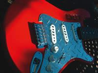 Red solid body electric guitar