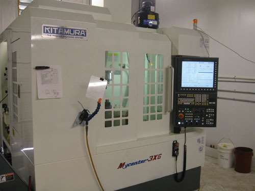 dual-contact spindle interface and laser toolsetting