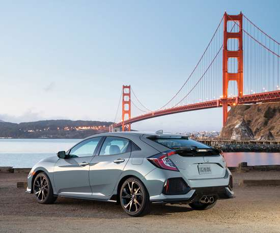 """The design is more about sportiness than utility. Yes, this is a five-door. But if you want one design cue that says """"performance"""" (well, within context, of course, as this is not the performance version of the Civic, which is to come in the form of the forthcoming Type R—which is based on the Hatch), note the double, centered exhaust pipes."""