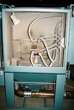 Automated blast finishing system.