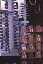 Parts are placed on titanium racks