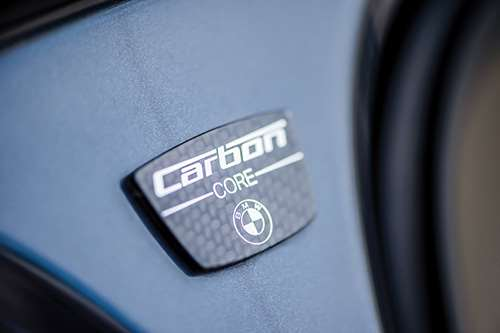 "How often does a vehicle have a badge that indicates one of the materials that it is constructed with? The 7 Series does. That's ""carbon"" as in carbon-fiber-reinforced plastic."