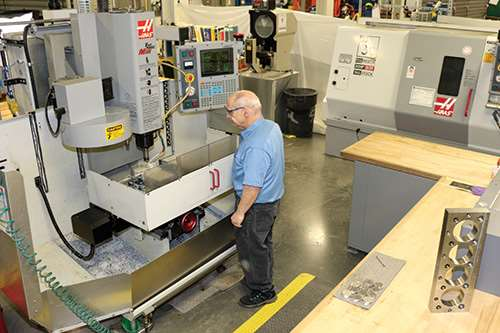 The facility has more than 30 machine tools, including the two Haas machines (haascnc.com) visible here.