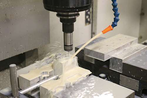 A racing throttle plate being milled.