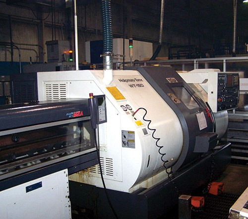 Nakumura-Tome WT-150 turning center with LNS bar feeder at Glueckler Metal.