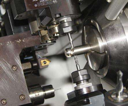 Close up of pinch mill on a swiss-type machine