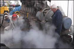 Spraying streams of dry ice pellets
