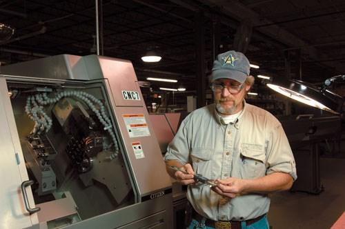 man inspecting part
