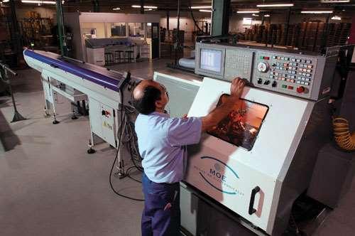 man operating CNC