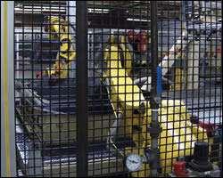 Robots trim bedliner