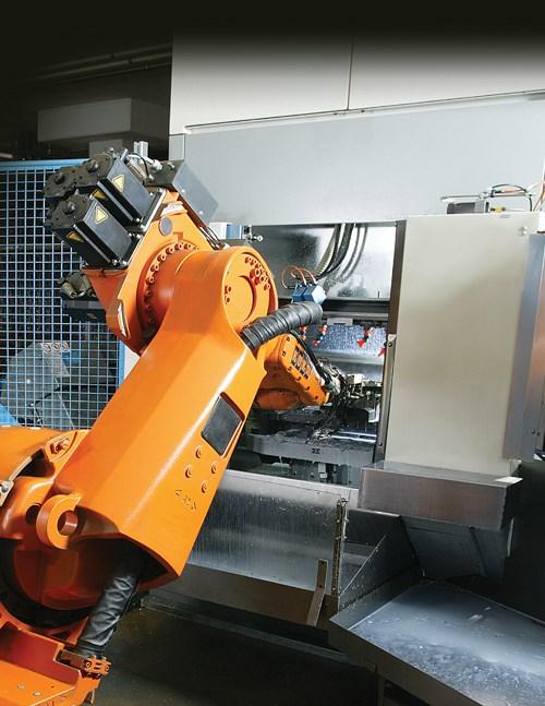 Industrial robot tending a CNC machine