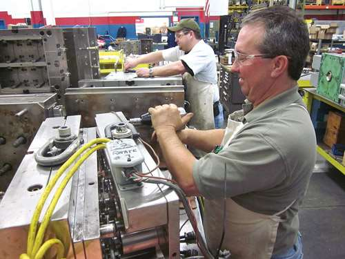toolmakers cleaning molds