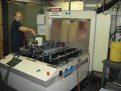 Don Donahey works on an automatic pallet changer