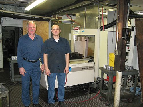Mark and John Lewkowicz in front of an automatic pallet changer