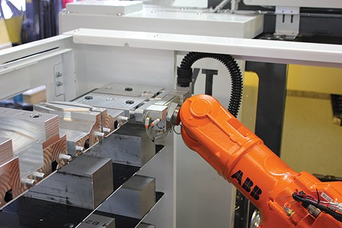 a robot arm picks up a soft-jaw tooling