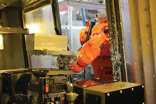 robot arm placing workpiece into machining center