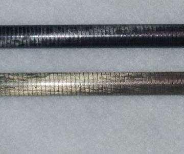 200-nm thick nickel coating vs. a plain carbon fiber composite