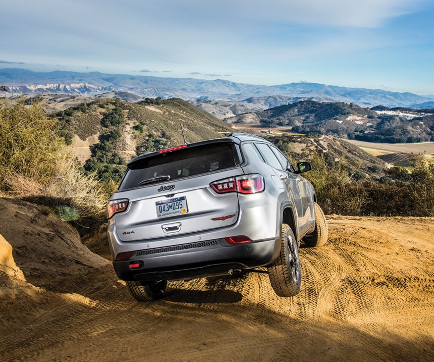 Look carefully at the right rear tire. Yes, it is off the ground. The Compass Trailhawk features the Jeep Active Drive Low 4x4 20:1 crawl ratio and Selec-Terrain with Rock mode. And skid plates. And were the vehicle to  be in water, know that it handles up to 19 inches of fording.
