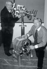 Advanced Engine Technologies, Inc. President Carroll Shelby and COO John Luft with a cutaway of the OX2 engine and a full-scale example