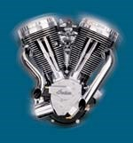 serrated billet rockers covers, polished pushrod tubes, and the Mikuni carburetor of the engine