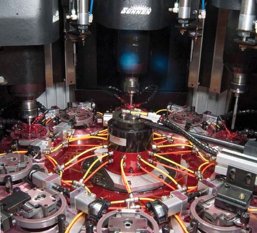 Automated 3 spindle hone.