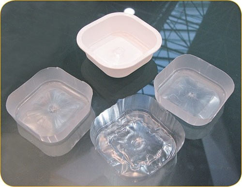 Injection molded Kortec barrier food container separated into PP and EVOH layers.