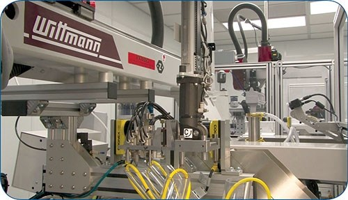 Automated cleanroom molding cell at MTD Micro Molding.