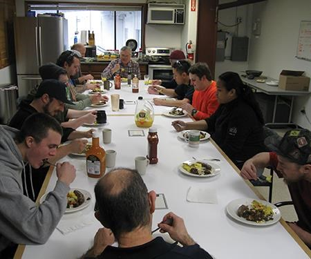 Peter Boucher and employees at breakfast