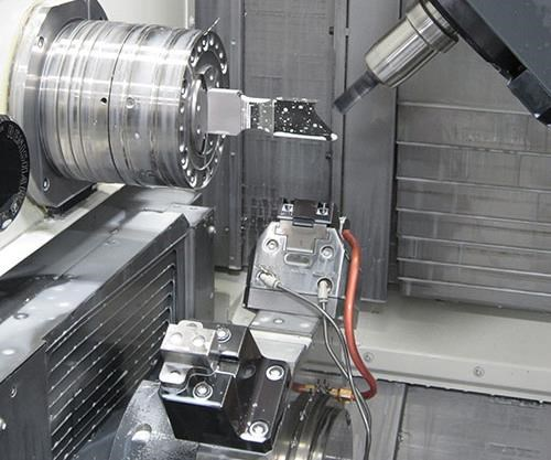 inside of Alpha Manufacturing & Design's turn-mill machine, which is used to manufacture medical device components