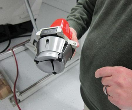man holding a new collet in a quick-change system