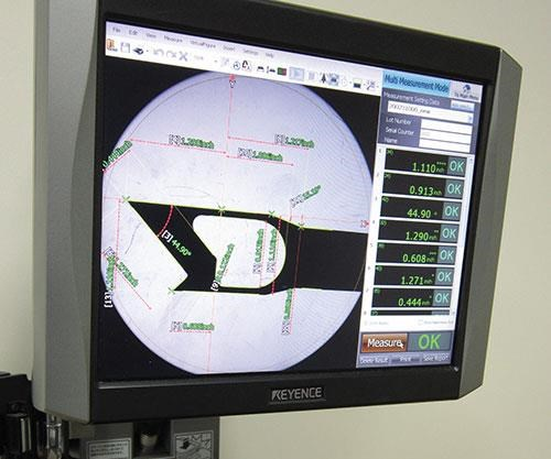 this Keyence IM series measurement system that uses a large-diameter lens and a CMOS camera to automatically measure as many as 99 points simultaneously.