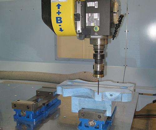 Probing is used to locate the inexpensive fixtures created for composites machining.