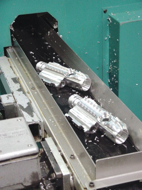 Parts exiting multifunction machine