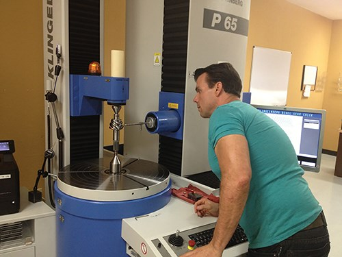 Thomas Alaniva inspects a spiral bevel gear
