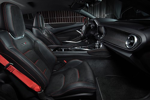 Standard Recaro front seats and a sueded flat-bottom steering wheel.
