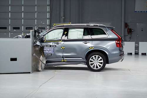 """Here is a Volvo XC90 undergoing the small overlap test at the Insurance Institute for Highway Safety (IIHS) facility. In case you're wondering, the second-generation of the full-size SUV received an IIHS Top Safety Pick+ rating, having both the fundamental structure necessary to meet the crash tests as well as the technology necessary to help avoid or mitigate front-end collisions. As for the first point, some 35 percent of the vehicle's body-in-white is made with hot-stamped boron steel. Then there is an array of technology under the banner """"City Safety"""" that is based on radar and camera technology housed in the vicinity of the rearview mirror that helps prevent collisions by warning the driver and fully applying the brakes should the warning be ignored."""