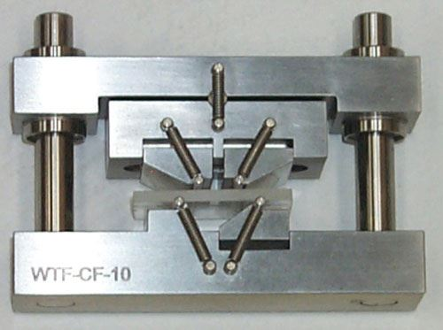Fig. 1: A fully articulated, four-point loading flexure fixture.