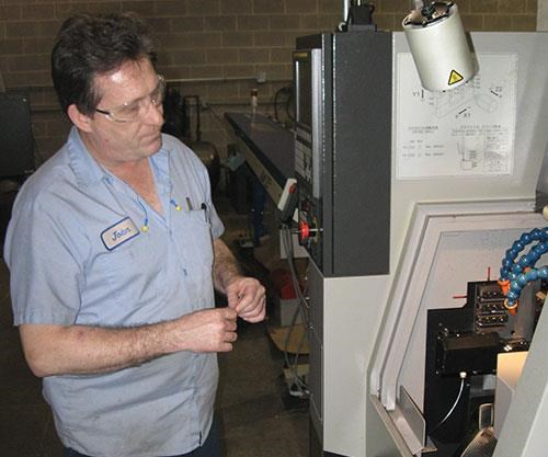 John Groth programming a CNC lathe